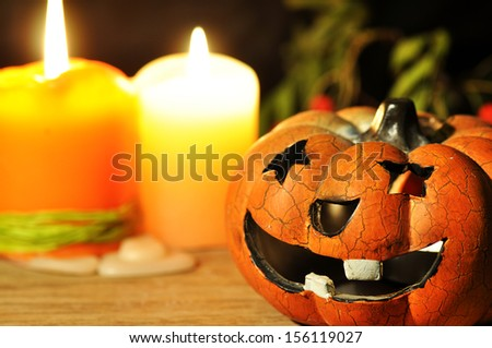 Halloween pumpkin (lampion) and candles