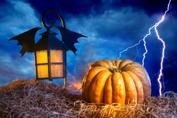 Halloween. Pumpkin, lantern and lightning. Halloween background. Illustration for all saints eve. Background with a lantern and a Halloween pumpkin.