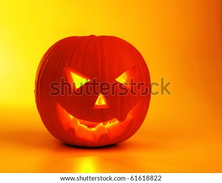 Halloween pumpkin lantern, glowing holiday background