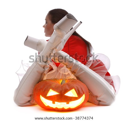 Halloween pumpkin laying between legs of girl isolated on white
