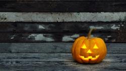 halloween pumpkin on wood plank background