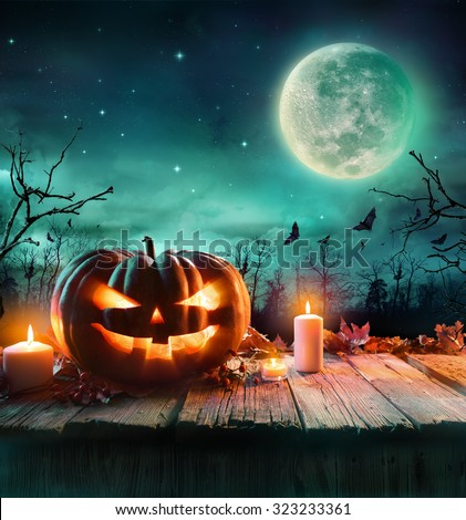 Halloween Pumpkin On Wooden Plank With Candles In A Spooky Night  #323233361