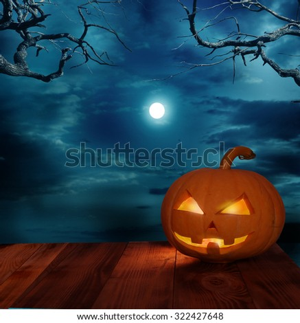 halloween pumpkin on wooden table #322427648