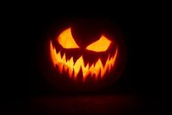 Halloween pumpkin's grin on black isolated background