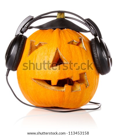 Halloween Pumpkin.Scary Jack O'Lantern in headphones isolated on white background