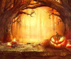 Halloween pumpkin. Scary pumpkin on table. Halloween background. Pumpkins in forest