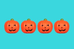 Halloween Pumpkin Toys on lined up on blue background./Halloween Concept