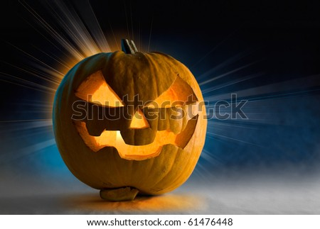 Halloween pumpkin with burning candle inside