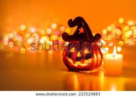 Halloween pumpkin with candlelight and bokeh background - Shutterstock ID 223524883