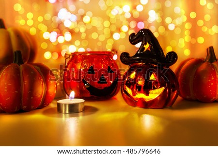 Halloween pumpkin with candlelight and bokeh background - Shutterstock ID 485796646