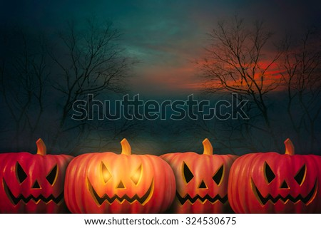 Halloween Pumpkin with silhouette tree background at night #324530675
