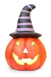 Halloween pumpkin with witch hat. Isolated on white background with natural shadow. With light inside. Shining pumpkin with witch's hat.