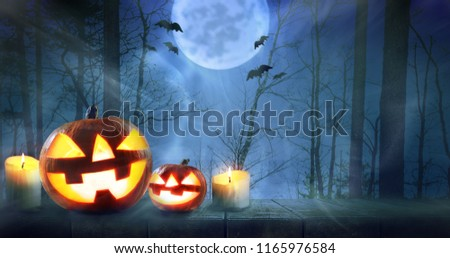Halloween pumpkins against night scary autumn forest background #1165976584
