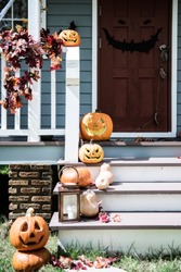 Halloween pumpkins and decorations outside a house