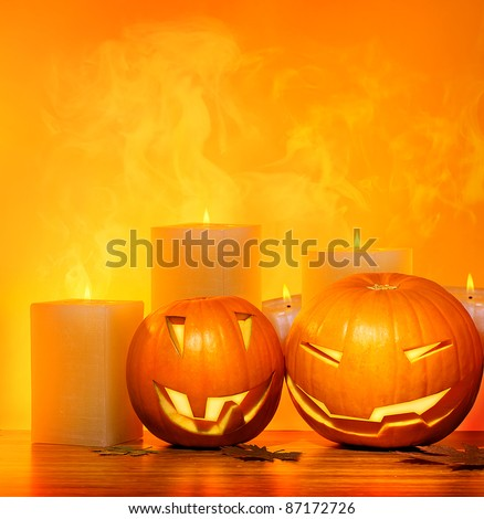 Halloween pumpkins holiday border, with candles and smoke, traditional jack-o-lantern over warm yellow light, night party decoration, fun concept