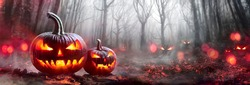 Halloween Pumpkins In A Spooky Forest At Night With Evil Eyes