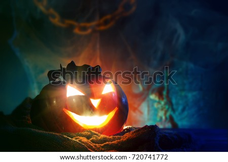 Halloween pumpkins on a wooden table at night. #720741772