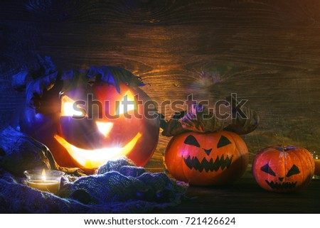 Halloween pumpkins on a wooden table at night. #721426624