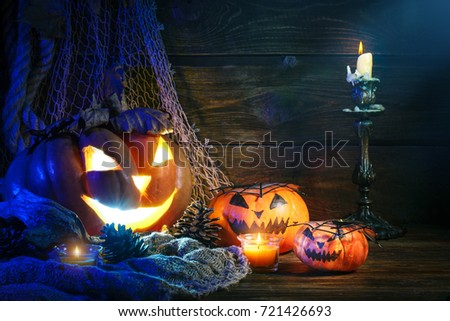 Halloween pumpkins on a wooden table at night. #721426693