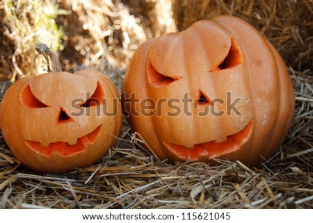 Halloween pumpkins on hay - stock photo