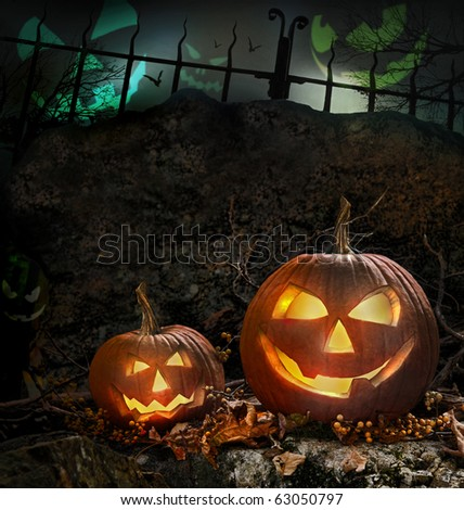 Halloween pumpkins on rocks in a forest at night