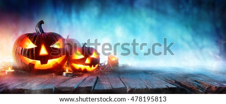 Halloween Pumpkins On Wood In A Spooky Forest At Night  #478195813