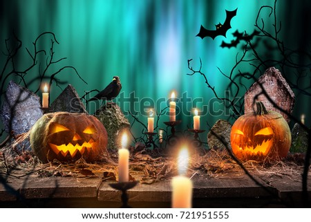 Halloween pumpkins on wooden planks with spooky background. #721951555
