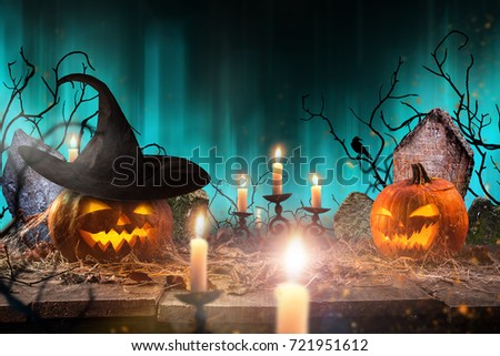 Halloween pumpkins on wooden planks with spooky background. #721951612
