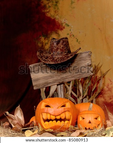Halloween pumpkins with wooden sign
