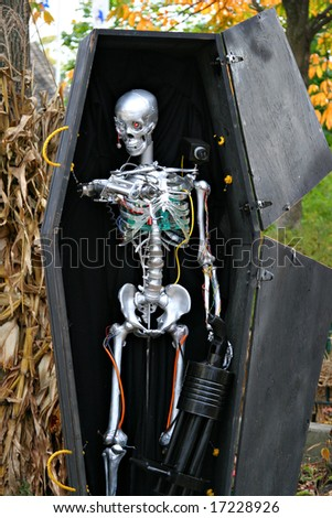 Halloween robot skeleton in a coffin decoration stock for Robotic halloween decorations