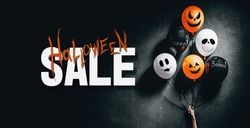 Halloween Sale special offer banner with scary air balloons for halloween over dark background