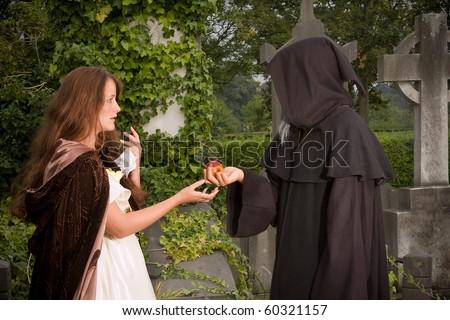 Halloween scene of an evil monk offering an apple