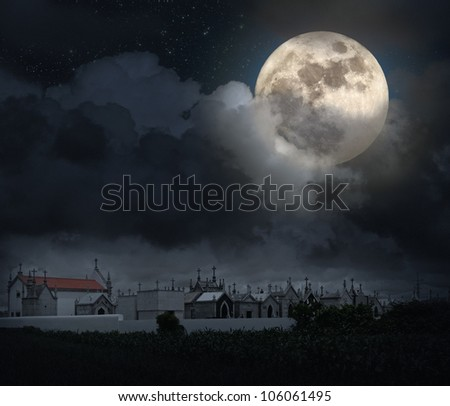 Halloween scenery with full moon, cloudy sky, and old European cemetery (digital grain added)