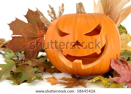 Halloween shot with autumn leaves and a fine Jack-o-Lantern on white background