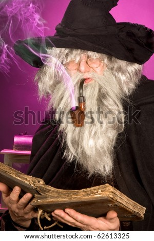 Halloween sorcerer with purple smoke leaving his pipe