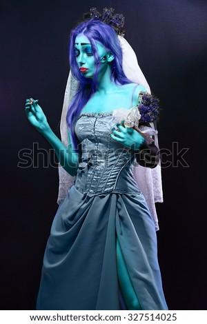 Stock Photo Halloween: Sorrow scene of a corpse bride under blue moon light. Beautiful ghost zombie