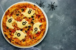 Halloween spooky ghost pizza - easy, healthy and delicious fun food party treats for kids top view blank space for text