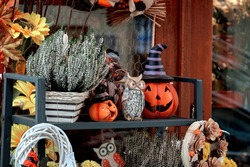 Halloween street decor with fresh fall pumpkins and flowers.