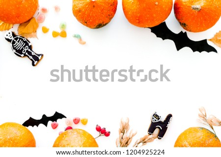 Halloween symbols. Pumpkins and cute figures of halloween evils. Bats. white background top view #1204925224