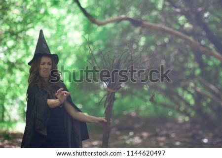 Halloween. The witch is funny. The old broom. The broom broke. The squeamish witch in the hood of the witch #1144620497