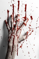 halloween theme: bleed hand print on a white leaves bloody wall