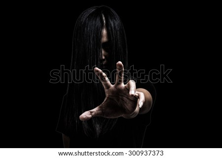 Halloween theme:Ghost Girl Horror isolated on black background.film filter effect.with clipping path.