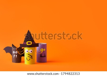 Halloween toy collection on orange for Halloween party concept background. Paper crafts, easy DIY. Handcraft creative idea from toilet tube, recycle reuse, copy space, flyer, banner Сток-фото ©