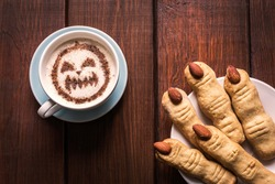 Halloween witch finger cookies for kids, funny recipe for Halloween party. Homemade cookies in the form of terrible human fingers decoration almond nail for treat kids for Halloween party