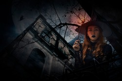 Halloween witch holding magic wand standing over grunge castle, dead tree, bird fly, full moon and cloudy spooky sky, Halloween mystery concept