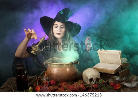 halloween witch making a potion