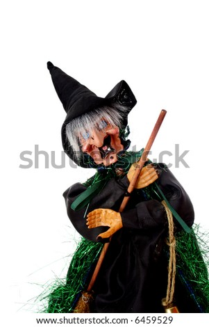Halloween witch with a black hat and a broom