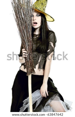 Halloween witch with a broom isolated over white background.
