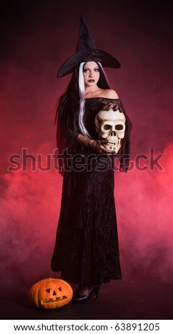 Halloween witch with a skull and pumpkin with red smoke