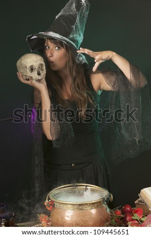 halloween witch with skull and cauldron